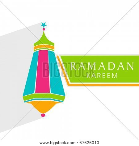Colorful arabic lantern with stylish text on green stripe for holy month of Muslim community Ramadan Kareem.