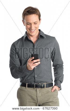 Portrait Of Happy Young Man Using Cellphone Isolated On White Background