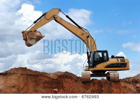 Excavator With Raised Bucket