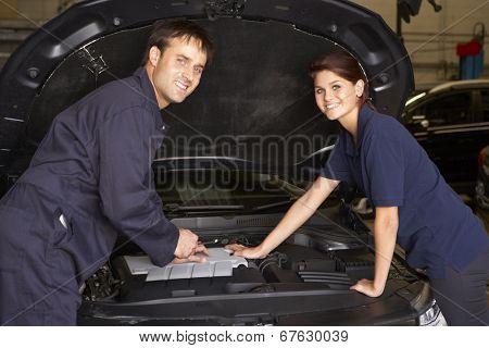 Female trainee mechanic at work