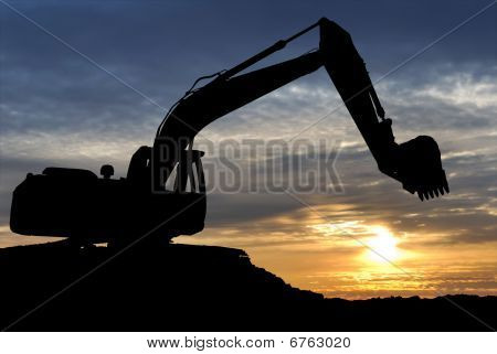 Loader Excavator Over Sunset
