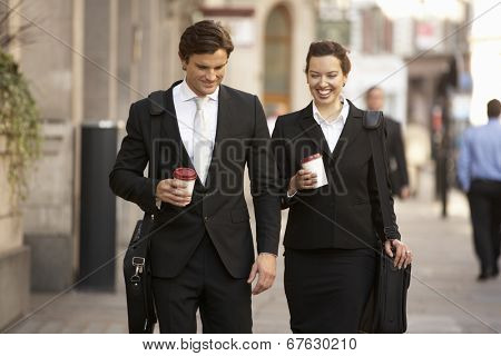 Businessman and businesswoman on their way to work