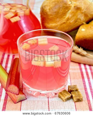 Compote From Rhubarb In Glass And Jug On Cloth With Bread