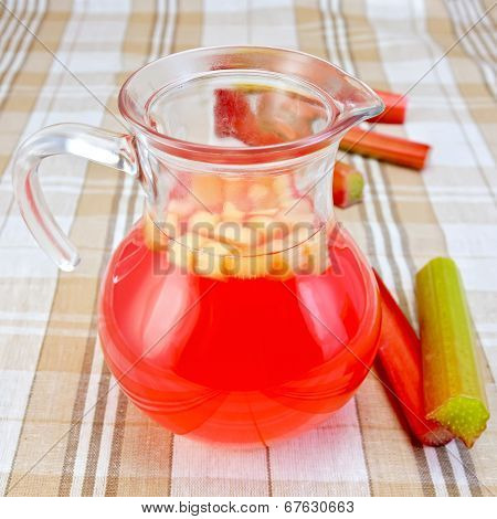 Compote From Rhubarb In A Jug On Tablecloth