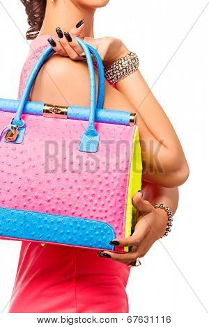 woman with bright summer bag on isolated studio background