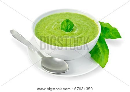 Soup Puree With Spinach In A Bowl And Leaves