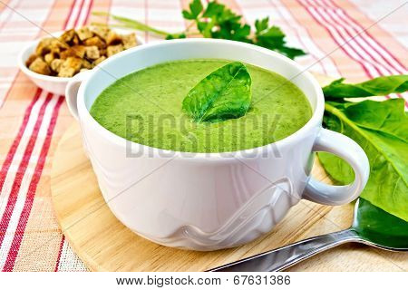 Soup Puree With Spinach Leaves On Fabric