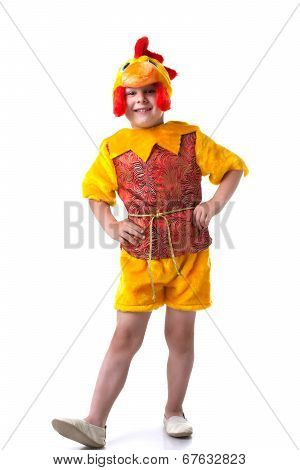Funny little boy posing in cockerel suit
