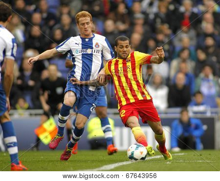 BARCELONA - MARCH, 29: Daniel Alves(R) of Barcelona vies with Alex Fernandez(L) of Espanyol during a spanish league match at the Estadi Cornella on March 29, 2014 in Barcelona, Spain