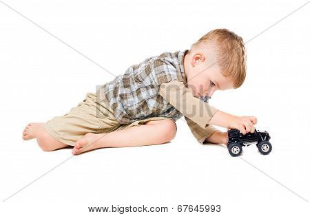 Cute boy playing toy car