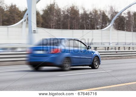 Blured Car Riding On Road