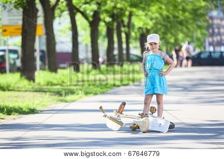 Girl In The Park Standing Near Fallen Bicycle