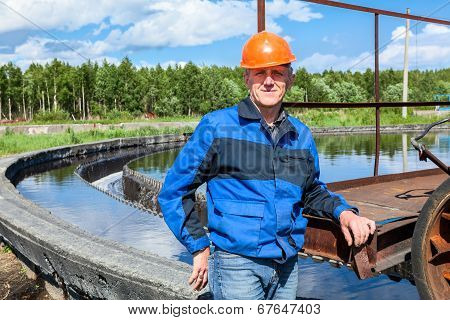 Portrait Of Senior Workman In Blue Uniform On Industrial Plant