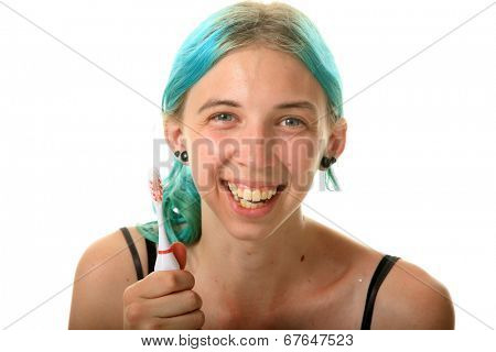 A young woman with blue hair, is excited about brushing her teeth. Isolated on white with room for your text.