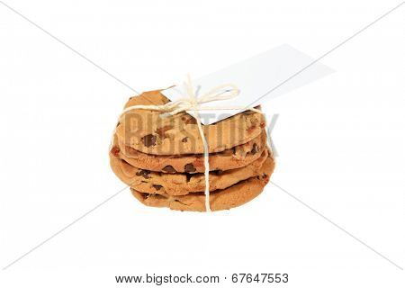 Genuine Chocolate Chip Cookies, they can also be medical cannabis cookies aka edibles. Tied together with a white string and a blank gift tag.  Isolated on white with room for your text.