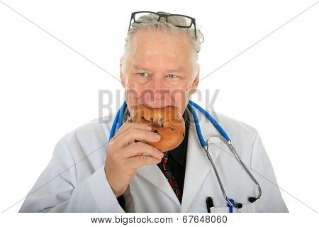 Even world famous Cardiac Surgeons like Dr. Ventricle need to eat. Here the good doctor eats a fresh Bagel for breakfast. Isolated on white with room for your text.