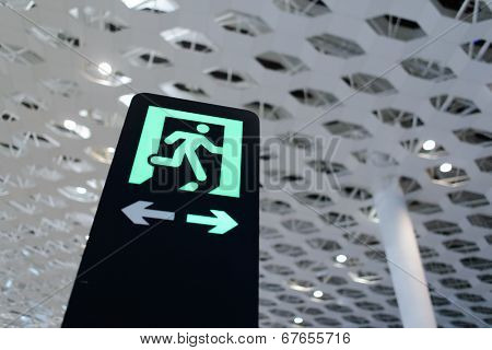 SHENZHEN - APRIL 16: exit sign in airport on April 16, 2014 in Shenzhen, China. Shenzhen Bao'an International Airport is located near Huangtian and Fuyong villages in Bao'an District, Shenzhen
