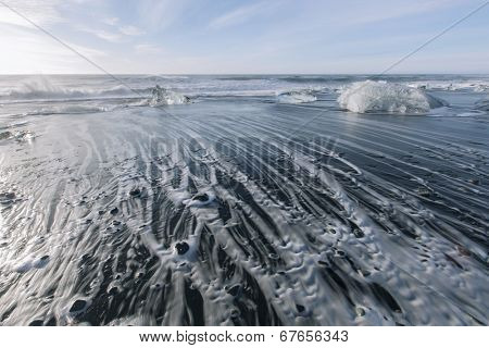 Melting ice on beach near Jokulsarlon in Iceland
