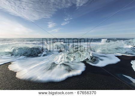 Melting ice on beach near Jokulsarlon in Iceland