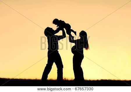 Silhouette Of Happy Family Celebrating Pregnancy