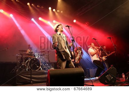 LOULE - JUNE 28: La Selva Sur a pop music band from Spain performs on stage at festival med, a world music festival in Loule, Portugal, June 28, 2014