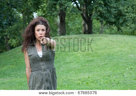 Young Woman Angrily Poinitng