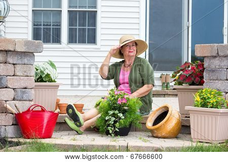 Elegant Grandma Posing As She Pots Up Plants