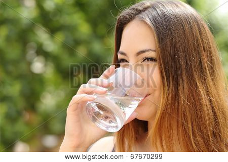 Happy Woman Drinking Water From A Glass Outdoor