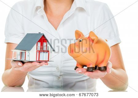 a woman with a house and a piggy bank. the right financing for the home purchase.