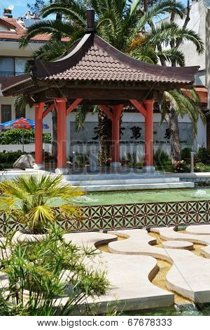 MARMARIS, TURKEY - MAY 14, 2014: Arbor and fountain in Jinan park. Chinese town of Jinan is the sister city of Marmaris since 2009