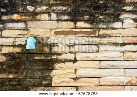 Pipe Drain On A Brick wall