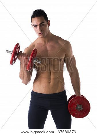 Muscular Shirtless Young Man Exercising Biceps With Dumbbells