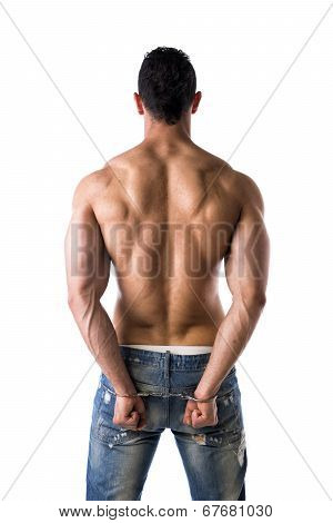Back Of Muscular Shirtless Young Man With Handcuffs