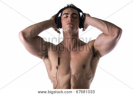 Muscular Man Shirtless, Listening To Music On Headphones