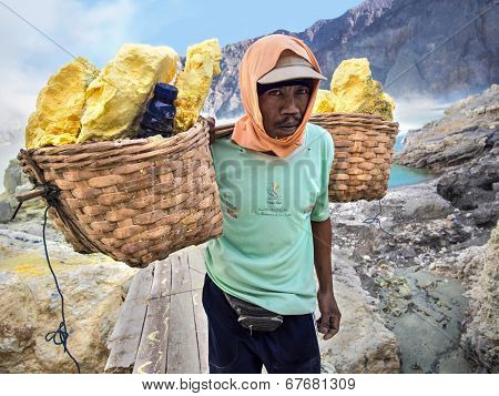 Sulfur Miner At Kawah Ijen Volcano, East Java, Indonesia