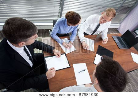 Co-workers During Meeting In The Office