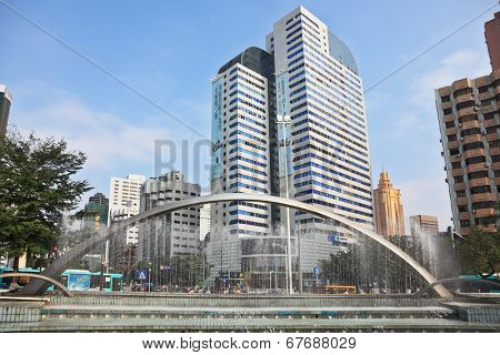 SHENZHEN -  CITY IN SOUTH OF  PEOPLE'S REPUBLIC OF CHINA - NOVEMBER 19, 2011:  The magnificent modern city with wide prospectuses and skyscrapers. Picturesque fountain in the city center