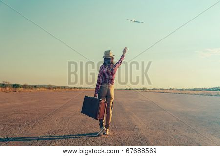 Traveler Woman Waves Her Hand To Airplane