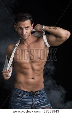 Handsome Muscular Man Pulling Up T-shirt On Naked Torso