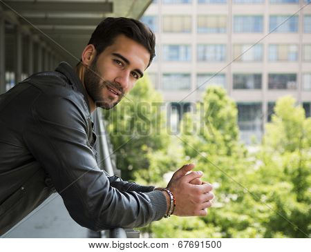 Profile  Shot Of Attractive Bearded Young Man In City