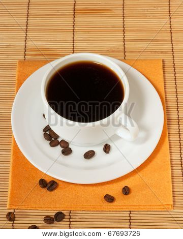 White Coffee Cup And Saucer On The Table