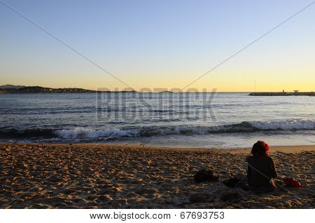 Woman Sitting On Beach In Bandol, France