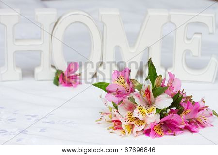 alstroemeria flowers with home sign