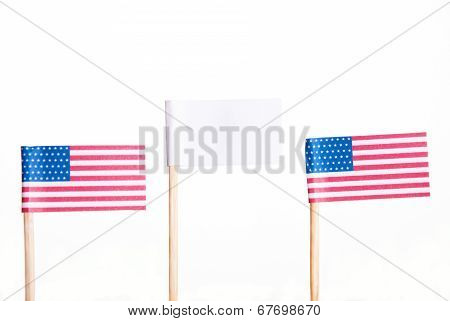 American Flags With A White Banner In The Middle