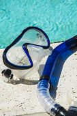 pic of breather  - Breather and mask snorkel gear by a pool - JPG