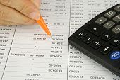 pic of accountability  - Man hold orange pen is planning finance account with calculator - JPG