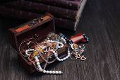 picture of vintage jewelry  - Nice vintage open box full of various jewelry on dark wooden background - JPG