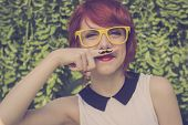 pic of teenagers  - Cute hipster teenage girl with mustache hand drawn on a finger she placed over her lips cute and funny - JPG