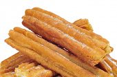 image of churros  - a pile of churros typical of Spain on a white background - JPG