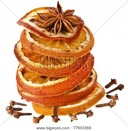 Christmas sliced dried orange with cinnamon and anise on a white background